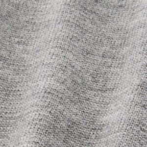 Eine Detailaufnahme von einem glattgestrickter Merinowolle.